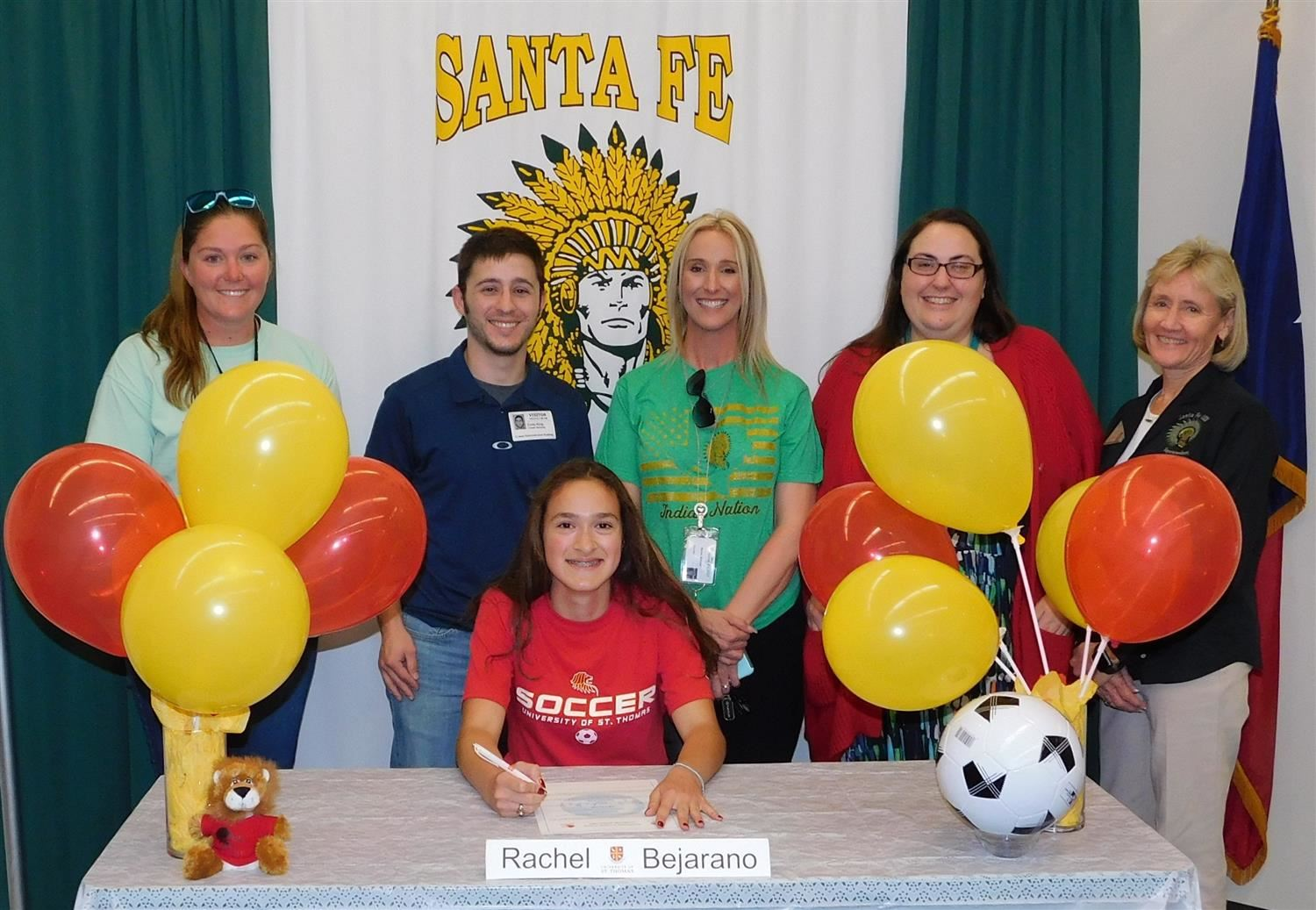 Rachel Bejarano Signing with staff pictured